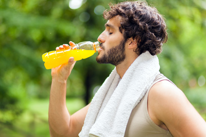 Young man drinking after sport