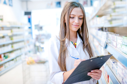 portrait of blonde pharmacist or health care worker with clipboard